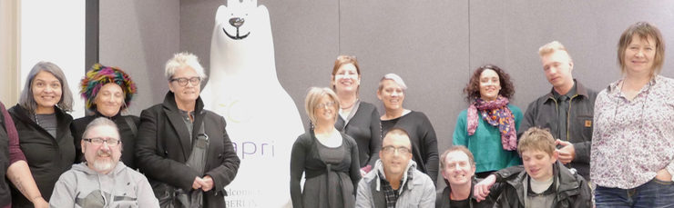First official Australia and Berlin Arts Exchange Project tour photo of artists, carers, interpreters and management stand with the Berlin Bear in the foyer of the hotel Capri by Fraser in Berlin