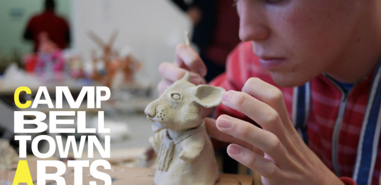 Photo of a young man working on a clay sculpture of a rabbit, overlaid with the words Cambelltown Arts Centre