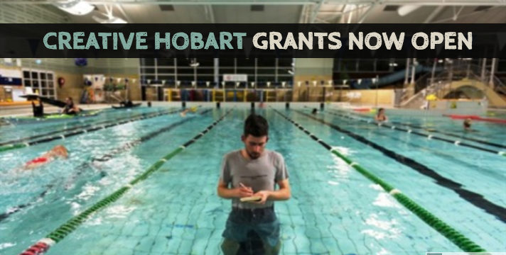 Photo of a swimming pool with a man standing fully clothes in the middle. Above, copy reads: Creative Hobart Grants Now Open