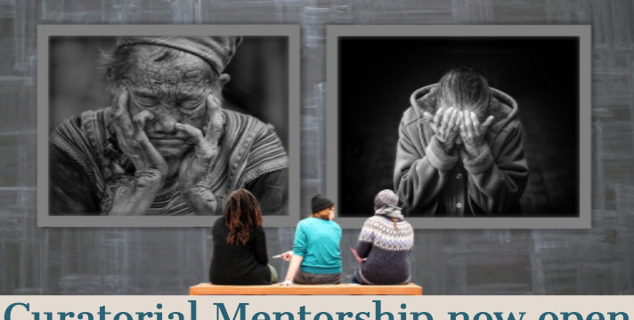 Three people sit on a bench at an art gallery with their backs to the camera. They view two oversized black and white portraits of a man. Overlaid text reads: Curatorial Mentorship now open