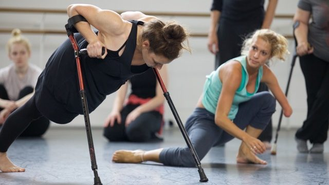 Two dancers with visual disability rehearse together.