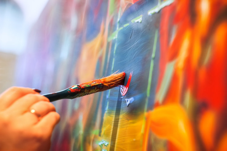 painting brush on wall different colors background