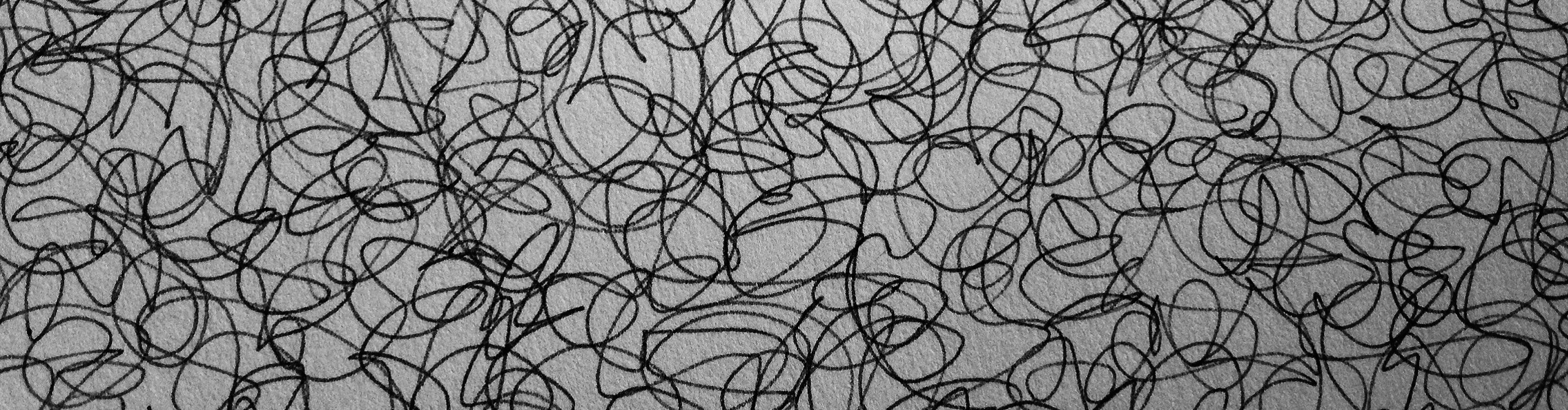 The image shows biro ink on paper in a graceful 10m long, meditative stim. It appears as one long unbroken line forming small swirls.