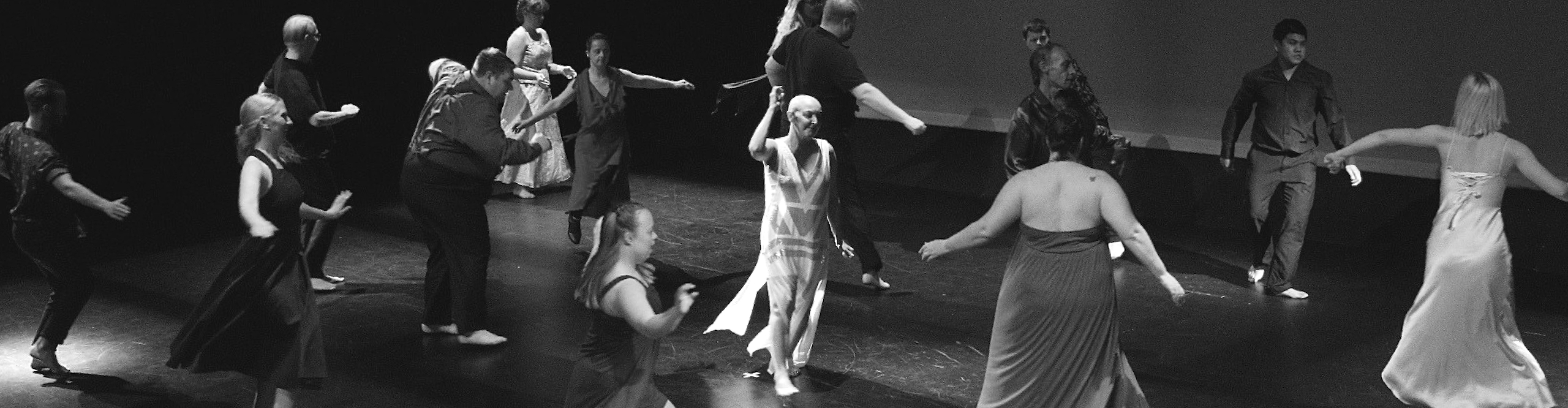 sixteen people of different ages, genders, race and appearance dance on stage.